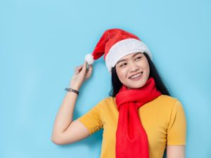 Woman in Santa hat with braces in Dayville