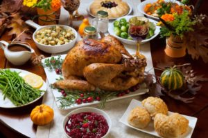 Dinner table full of holiday foods to eat with braces in Dayville