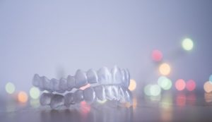 Invisalign in Dayville in front of Christmas lights