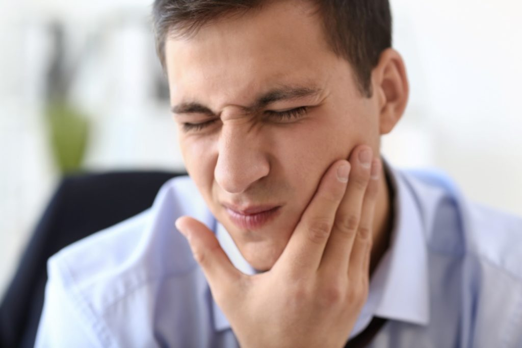 Closeup of man experiencing tooth pain