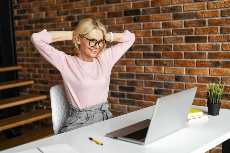 Woman with good posture sitting at work desk